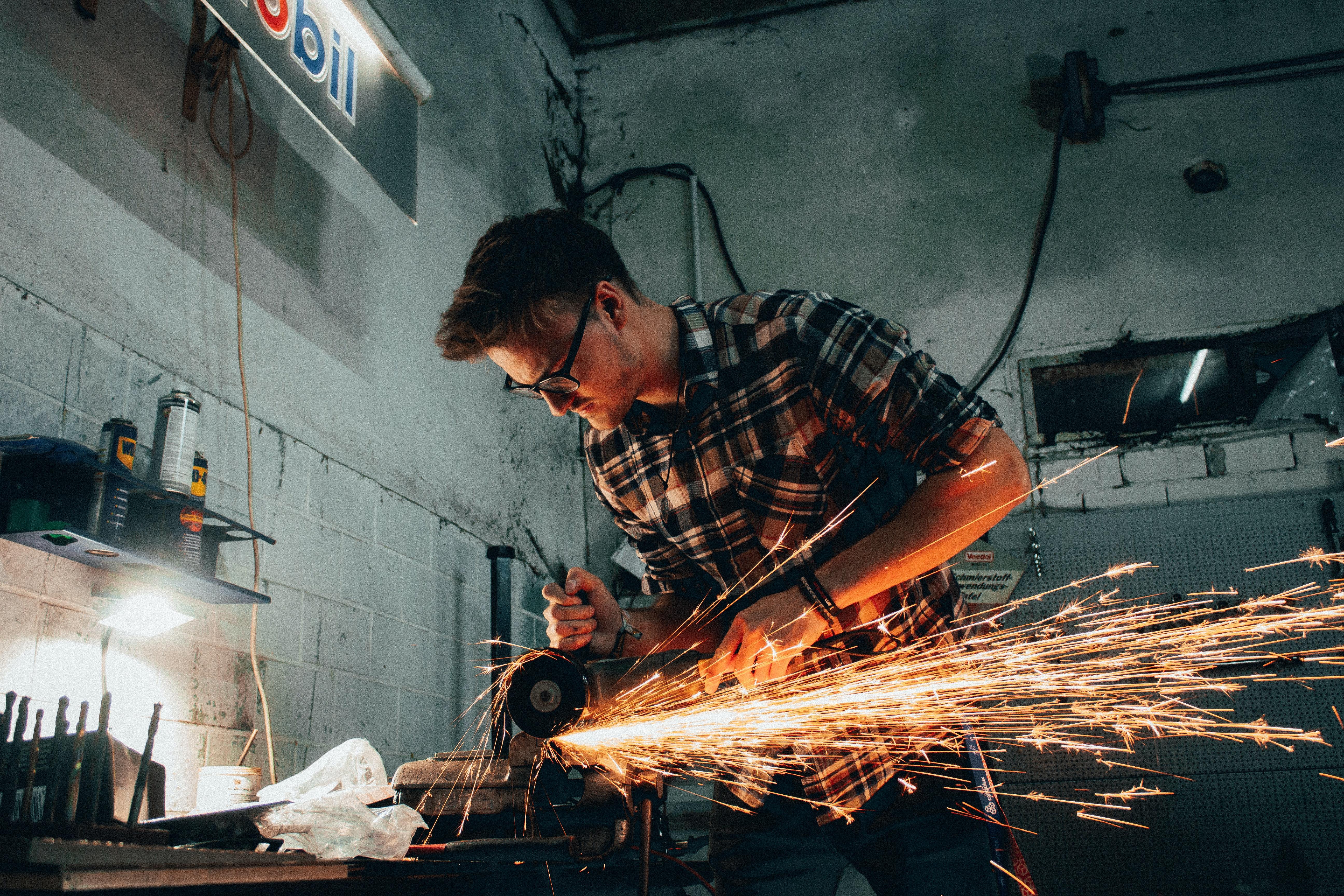 man welding iron | in-demand jobs in Canada